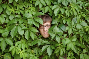 A young man among the thickets of ivy.